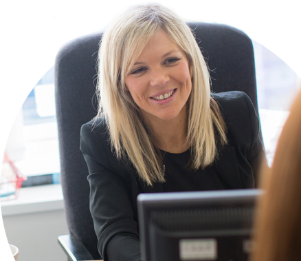 Solicitor sitting at her desk with a client